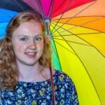 Teenage girl under colored umbrella — Stock Photo #76058037