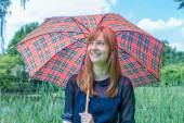 Girl with rain under umbrella in nature — Stock Photo