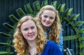 Two dutch teenage girls in front of water mill — Stock Photo