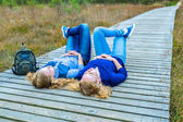 Two girls lying on their backs in nature — Stock Photo