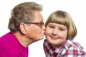 Dutch grandmother kisses grandchild on cheek — Stock Photo