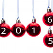 Red christmas balls with numbers of old and new year — Stock Photo #76904599