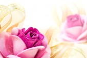 Rose and ribbon — Stock Photo