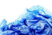 Blue plastic garbage bags on a white background — Stock Photo
