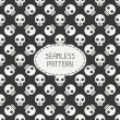 Geometric hipster seamless pattern with skulls and bones. Wrapping paper. Scrapbook paper. Tiling. Vector illustration. Background. Graphic texture for design. Happy Halloween. Trick or treat. — Stock Vector #79213750