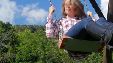 Beautiful young woman on a swing slow motion — Stock Video