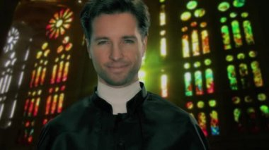 Portrait of a young catholic priest — Stock Video