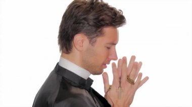 Young catholic priest saying a prayer — Stock Video