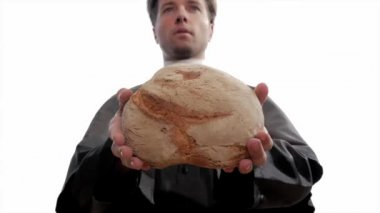 Young catholic priest breaking bread — Stock Video