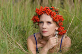 Young woman with rowan crown — Stock Photo