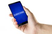 Subscribe word on digital smart phone — Stock Photo