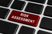 Risk assessment button on keyboard — Stock Photo