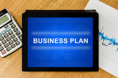 Business plan word on digital tablet — Stock Photo