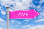 Pink road sign with love word — Stock Photo