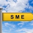 Yellow road sign with small and medium sized enterprise or SME — Stock Photo #58657887
