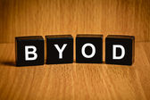 BYOD or Bring your own device word on black block — Stock Photo