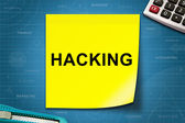 Hacking word on yellow note — Stock Photo