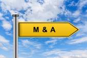Yellow road sign with M&A or Merger and acquisition words — Stock Photo