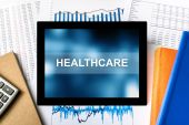 Healthcare word on tablet — Stock Photo