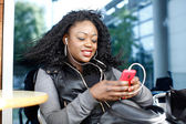 Black Female Listening Music from Phone Play List — Stockfoto