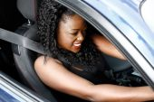 Young Black Woman Driving in Safety Seat Belt — Стоковое фото