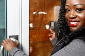 Young African woman entering a building — Stock Photo