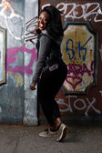 Happy Black Woman Posing at Wall with Vandals — Stock Photo
