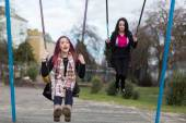 Two Teenage Girls Swinging on Swings — Stock Photo