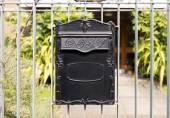 Close up Black Metal Post Box Hanging on Railings — Stock Photo