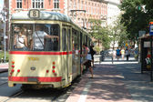 People getting on and off the tram in Poznan, Poland. — Stock Photo