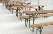 Row of empty tables and benches — Stock Photo