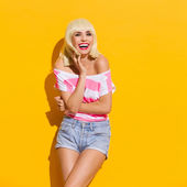 Laughing beautiful blonde young woman — Stock Photo