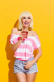 Smiling summer girl with a drink — Stock Photo