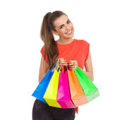 Girl with colorful shopping bags — Stock Photo