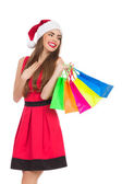Delighted christmas girl with shopping bags — Stock Photo