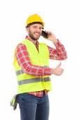 Smiling manual worker on the phone — Stock Photo