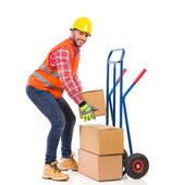 Delivery man picking up a package — Stock Photo