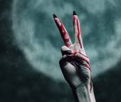 Vampire bloody hand with gesture peace sign — Stock Photo