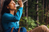 Hiker woman drinks water — Stock Photo
