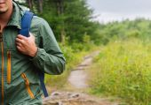 Hiker man walking on path in summer — Stock Photo