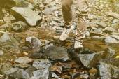 Traveler crossing the stream — Stock Photo