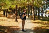 Hipster girl walking in park — Stock Photo