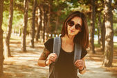 Smiling woman in park — Stock Photo