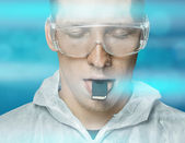 Young man with memory card on tongue — Foto Stock