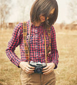 Hipster girl with vintage camera — Stock Photo