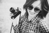 Hipster girl holding vintage camera — Stock Photo