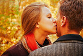 Young woman kissing man — Stock Photo