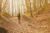 Hiker woman walking in forest — Stock Photo