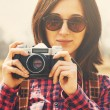 Woman with vintage photo camera — Stock Photo #64522077