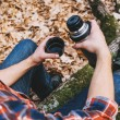 Hiker man holding thermos — Stock Photo #64522333